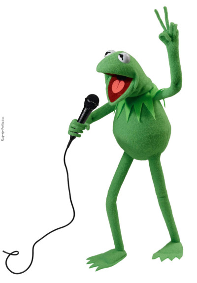 Kermit the Frog singing into microphone and making peace sign